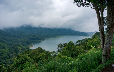 White clouds are covering the twin lakes Buyan and Tamblingan on Bali, Indonesia Фото со стока