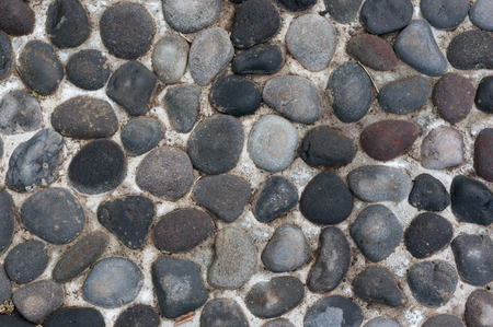Fragment of the wall with pebbles Фото со стока