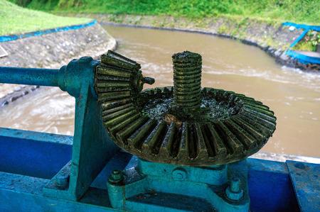 Old steel gear of dam in Indonesia Фото со стока