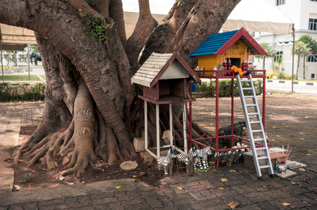 Wooden houses of spirits with gifts, Thailand Фото со стока
