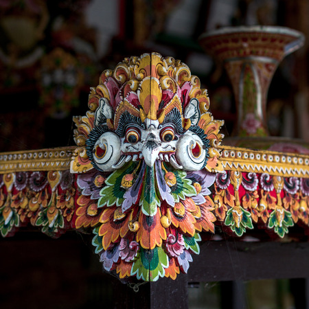 Mythological bird carved from the wood in traditional balinese style