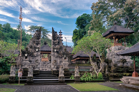 Empty area near the entrance with split gateway to the balinese temple Pura Gunung Lebah, Bali, Indonesia