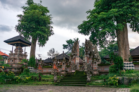 Empty area near the entrance with split gateway to the balinese temple in Ubud town, Bali, Indonesia