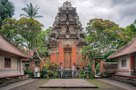 The tourist leaving the courtyard of Ubud palace that is the famous attraction on Bali, Indonesia