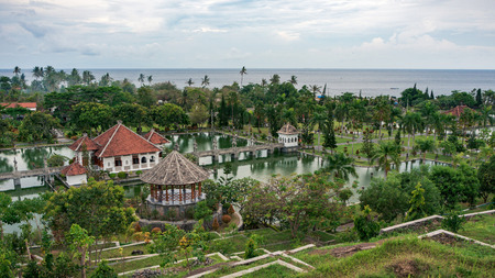 Panoramic view of the Royal water palace in Taman Ujung park which is situated near the ocean, Bali, Indonesia