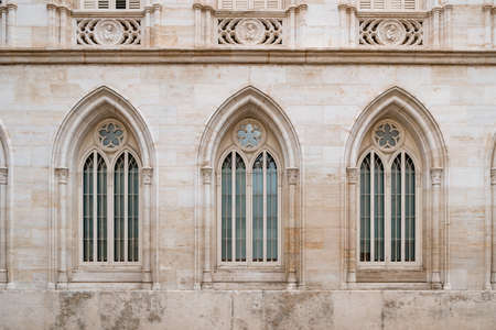Three gothic-style windows of ancient building in old town. 版權商用圖片