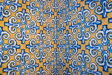 Colorful tiles with floral design on the wall of Mercado Central, Valencia, Spain. Arabesque background.