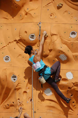 hardness: lady climber in a competition
