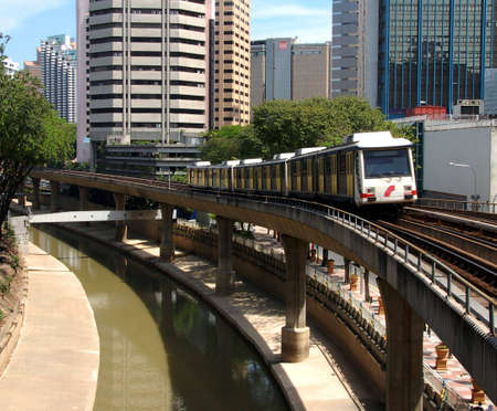 fare: mass transport system for City of Kuala Lumpur showing  train leaving a station
