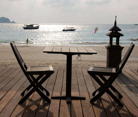 moon chair: Table for two in beach resort Pulau Redang, Malaysia Stock Photo