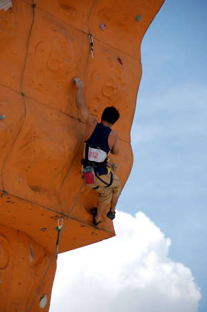 hardness: climber in a competition Stock Photo