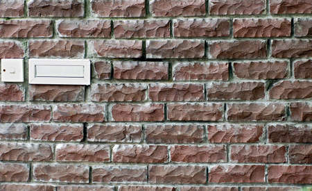brick wall with post box and door bell switch Stock Photo - 395860