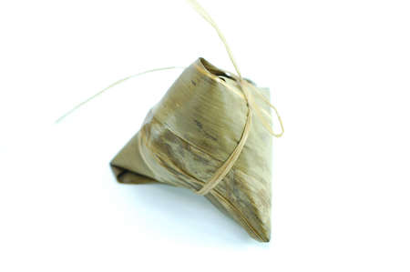 sticky rice pocket with spice and meat in bamboo leaf. a popular dish amongst chinese photo