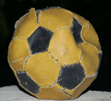 throwaway: worn-out football at the end of the rood ready to been thrown away