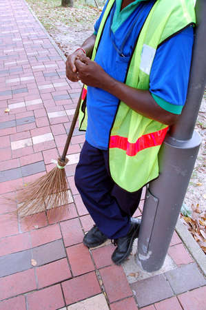 easy going: street sweeper and his broom