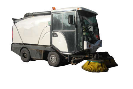 automative street sweeper showing water spraying, rotating brush and vacuum hose in action 写真素材