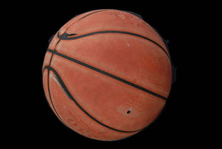 wornout: worn-out basketball at the end of the rood ready to been thrown away