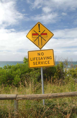 cautions: a sign showing no lifesaving service around the beach area Stock Photo