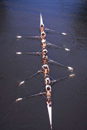 A rowing team pratice rowing in the evening on a smooth and calm river Stock Photo - 4367837