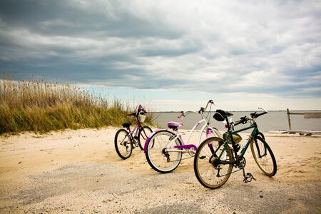 Bikes with logos removed at mothers beach in Bellport, New York. Stock Photo