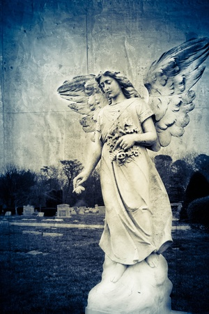 Stylized angel statue at a local graveyard. Archivio Fotografico