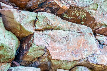 Boulders with moss and colorful patina.