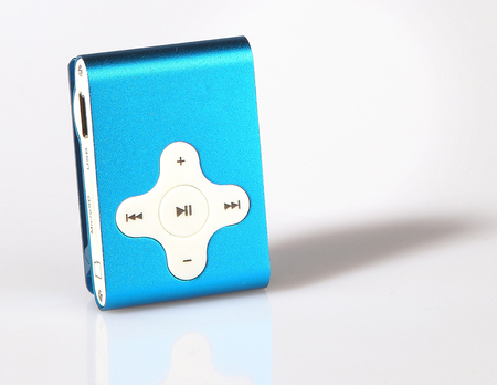 device mp3 player on grey table shadow reflection blue