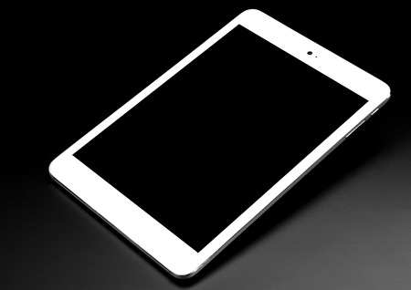 Tablet black silver metal on black background with shadow cutout isolated without screen side