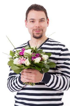 Smiling young man with bouquet of spring flowers photo