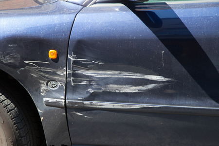 broken car: Blue car with scratches on drivers door