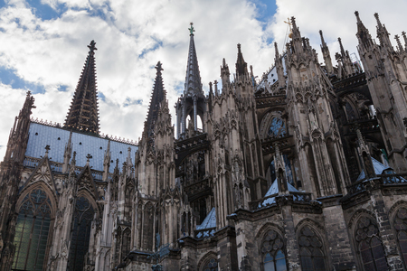 rear side with right aisle of the cologne cathedral with clouds and blue sky Stock Photo