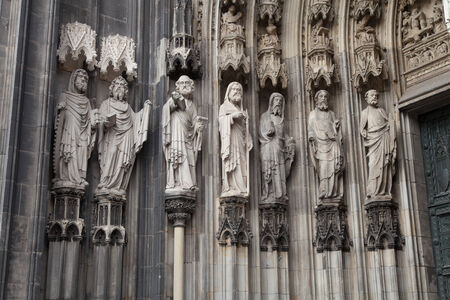 sainthood: Catholic saint figures at side entrance of the cologne cathedral