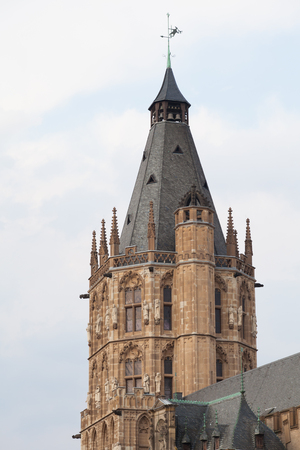 tower and roof of the historical town hall of Cologne with sky