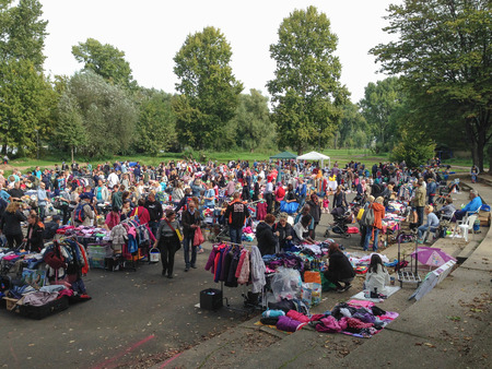 Cologne, Germany - September 28, 2014: flea market with many clothes and toys for kids. once a month parents and children visiting this flea market.