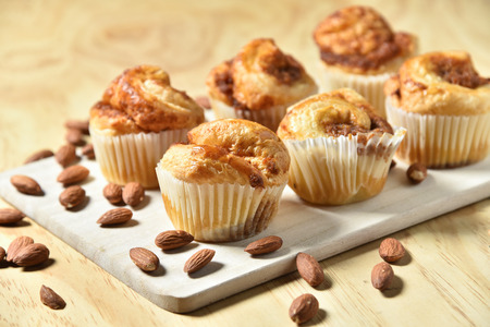 danish: Almond Danish Cupcakes on wooden background.
