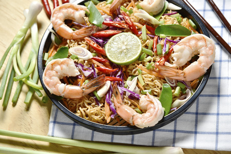 Top view Tom Yum Kung Noodle Spicy Fried Dried,Fried dried shrimp noodle,Thai food,Spicy Food.
