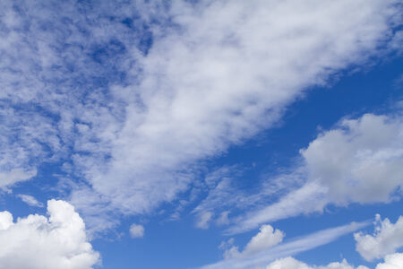 Clouds on the blue sky. Good for creating composite and brushes. Stock Photo