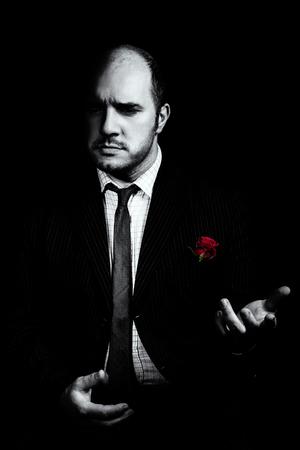 Portrait of man, godfather-like character. Black and white studio shot. Stock Photo