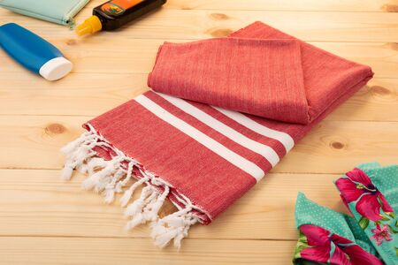 Handwoven hammam Turkish cotton towel on wooden background Stok Fotoğraf
