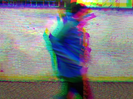 Photograph of a jogger passing by on a footpath, edited with video fx.