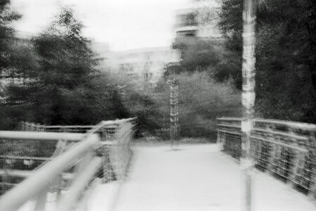 Blurred black and white analogue exposure of an industrial landscape.