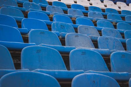 Rusty plastic blue and white stadium seats