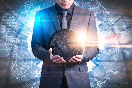 The abstract image of the businessman hold the virtual hologram on hand