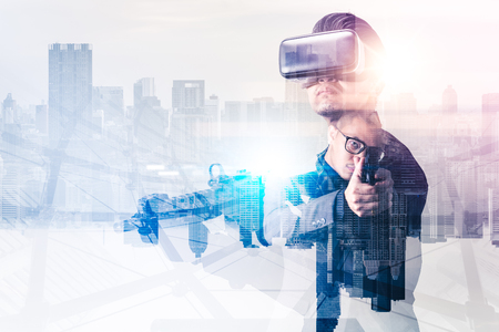 The abstract image of the soldier use a VR glasses for combat simulation training overlay with cityscape image. the concept of virtual hologram, simulation, gaming, internet of things and future life.