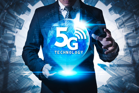 The abstract image of businessman using a smartphone overlay with 5g hologram.