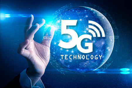 The abstract image of businessman hold the 5G hologram on his hand Banco de Imagens