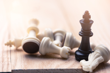 the abstract image of the chess set which has the king placed on chess board and the another in chess set placed around. the concept of strategy, victory, business, win, games, intelligence.