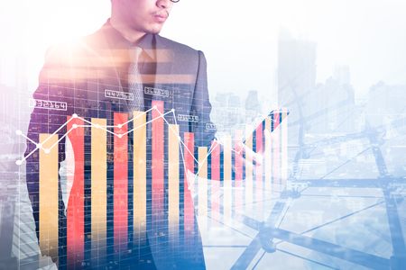 The double exposure image of the businessman using a smartphone during sunrise overlay with cityscape and business chart image. The concept of modern life, business, city life and internet of things. Reklamní fotografie