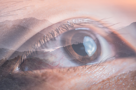 The double exposure image of the eye looking up overlay with nature image. The concept of nature, freedom, environment and business.