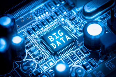 The abstract image of the chipset illumination on the computer mainboard overlay with big data text. The concept of big data, hardware, futuristic, information and technology.